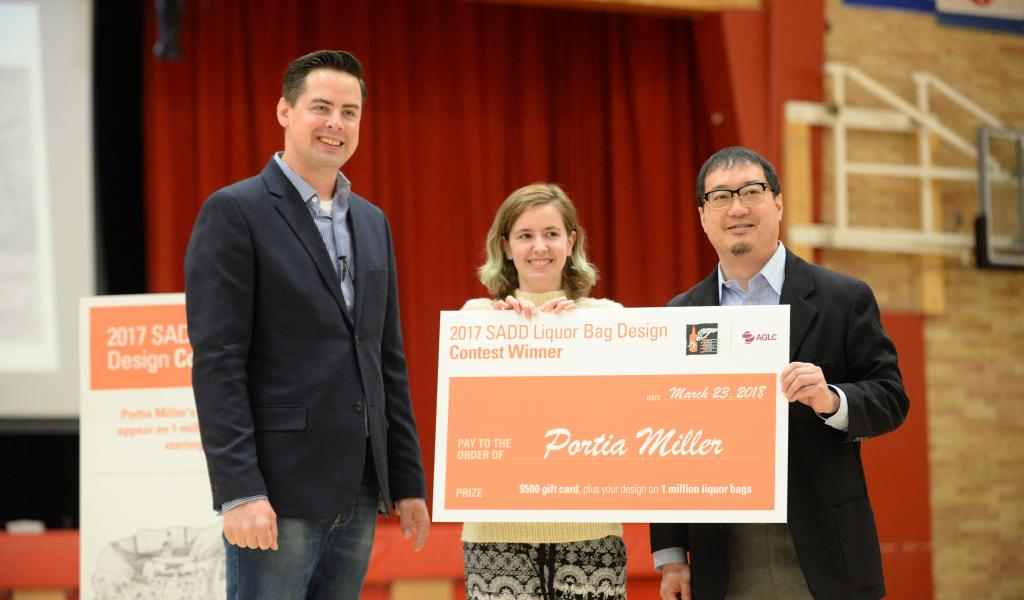 SADD Alberta Community Liaison, Arthur Lee and AGLC Communications Officer, Dan Huang congratulates Portia Miller, the 2017 Overall Winner for SADD Alberta's Liquor Bag Design Contest